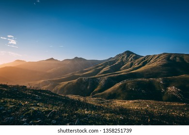 Beautiful view over the green mountains and hills during sunset, with a blue sky near Oudtshoorn, South Africa