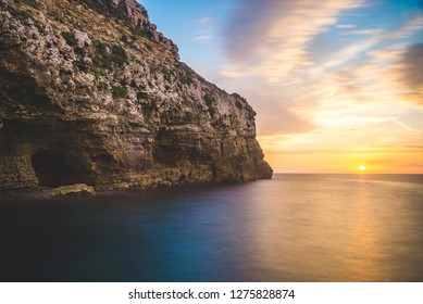 Beautiful view over Malta Island and the Mediteranean Sea, colorful sky and beautiful sunset colors
