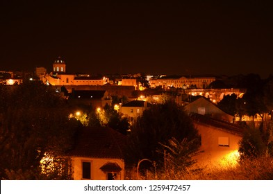 Beautiful view over portuguese Coimbra and its historical buildings at summer night taken from the stairs leading to the famous University of Coimbra. Photo: September 4th 2018