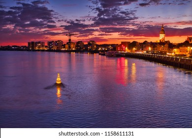 A beautiful view over a small city in Belguim, Temse. Near the river Scheldt. The sun is setting behind the city.