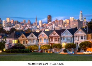 Beautiful view of Painted Ladies, colorful Victorian houses in a row at twilight, on a summer day with blue sky, San Francisco, California, USA