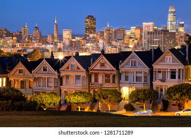 Beautiful view of Painted Ladies, colorful Victorian houses located near scenic Alamo Square in a row at twilight, on a summer day with blue sky, San Francisco, California, USA
