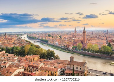 Beautiful view of the panorama of Verona and the Lamberti tower on the banks of the Adige River in Verona, Italy