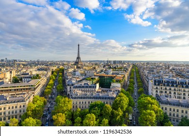 Beautiful view of Paris from the roof of the Triumphal Arch. Champs Elysees and the Eiffel Tower at sunset
