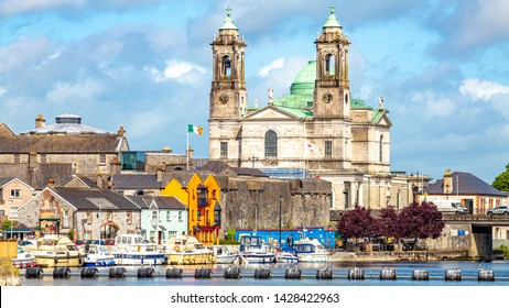 Beautiful view of the parish church of Ss. Peter and Paul and the castle in the town of Athlone next to the river Shannon, wonderful cloudy day in the county of Westmeath, Ireland