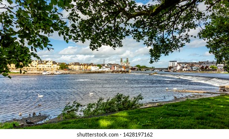 Beautiful view from a park of the river Shannon with the town of Athlone in the background, wonderful sunny day to enjoy in the county of Westmeath, Ireland