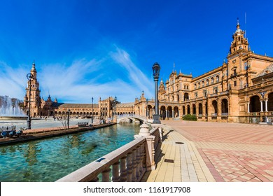 beautiful view of the plaza de espana in seville spain with its imposing building, its river and its fountain on a beautiful sunny day and a blue sky in the background