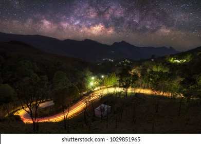 Beautiful view point of travel place, Dramatic long exposure sky with Milky way galaxy  and traffic light trails at Doi Pha Tang, Chiang Rai's Hidden Paradise,Thailand.