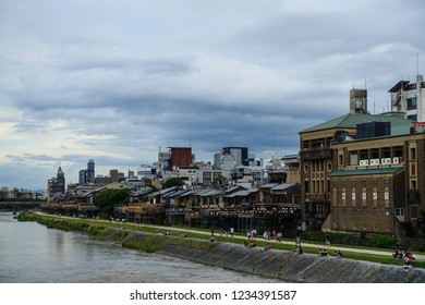 Beautiful view of Pontocho area near the Kamo River in Kyoto, People are chilling near the Kamo River, Japanese architecture and buildings, Kyoto, Japan, 29.06.2018