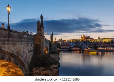 Beautiful view of Prague Castle at sunset from historical Charles bridge. Almost night in Prague, Czech Republic
