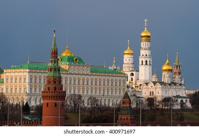 Beautiful view of red brick Moscow kremlin tower with golden church 's domes and the state kremlin palace in the evening  or sunset of middle spring. Capital of Russia