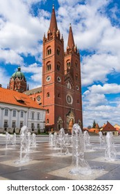 Beautiful view of the red Djakovo Cathedral or Basilica of St.Peter and the episcopate building on a sunny day in the town o Djakovo in eastern Croatia, Slavonia