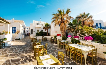 Beautiful view of restaurant and white architecture around on the sunshine greek street