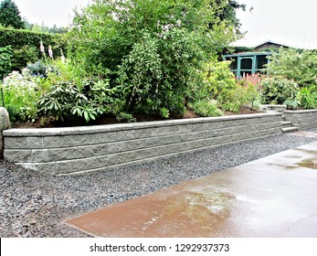 A beautiful view of a retaining wall built with concrete blocks incorporated into existing garden landscape design