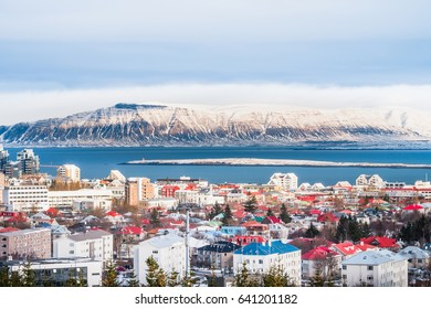 Beautiful view of  Reykjavik winter in Iceland winter season with snow-capped mountain in the background, Reykjavik is the capital city of Iceland with snow-capped mountain in the background.