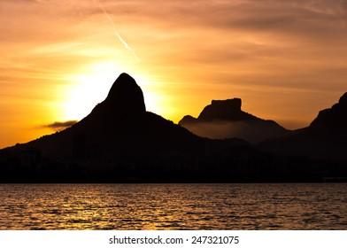 Beautiful View of Rio de Janeiro Sunset Behind Mountains at Rodrigo de Freitas Lake