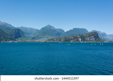 Beautiful view of Riva Del Garda and Nago-Torbole coastline and beaches with lots of windsurfers and boats, Italy.