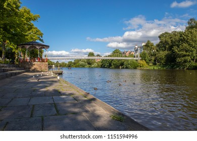 A beautiful view of the River Dee and the Dee Suspension Bridge in the historic city of Chester in Cheshire, UK.