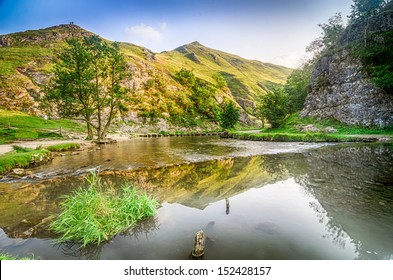A beautiful view of the river Dove and stepping stones at Dovedale in the English Peak District
