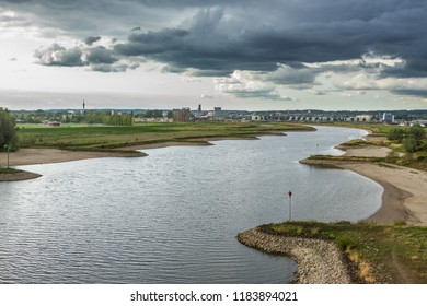 A beautiful view of the river the Nederrijn crossing the landscape along the Dutch city Arnhem.