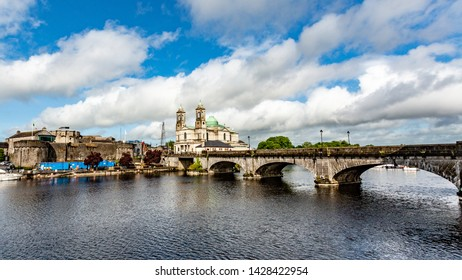 Beautiful view of the river Shannon, the bridge, the parish church of Ss. Peter and Paul and the castle in the village of Athlone, wonderful day in the county of Westmeath, Ireland