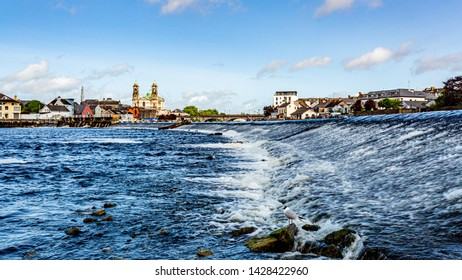 Beautiful view of the river Shannon with the parish church of Ss. Peter and Paul, their bridge in the village of Athlone in the background, wonderful sunny day in the county of Westmeath, Ireland
