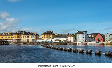 Beautiful view of the river Shannon and picturesque houses in the town of Athlone, wonderful and relaxed day in the county of Westmeath, Ireland