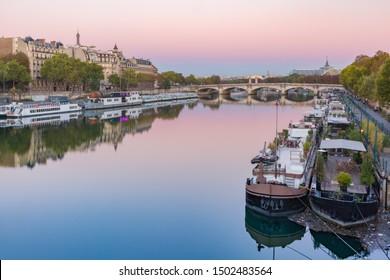 Beautiful view of riverside of Seine river and Pont de la Concorde at sunrise in Paris, France
