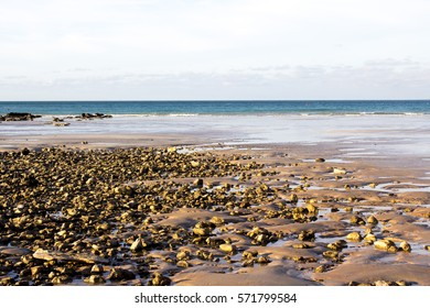 Beautiful view of the rocky  beach  at  Gantheaume Point, a red-sandstone rocky headland  near  beautiful Cable Beach, Broome, Western Australia on a late afternoon  in the  summer  Wet Season.