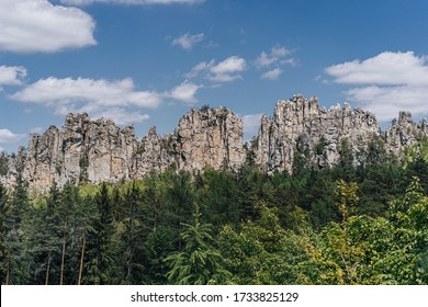 Beautiful view of the rocky ridge of Suche skaly (Dry Rocks), in Cuech paradise (Cesky raj). Fantastic sharp rock wall and sandstone formation of Suche skaly, Czech republic. - Shutterstock ID 1733825129