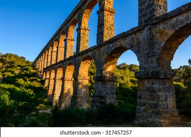 Beautiful view of roman Aqueduct Pont del Diable in Tarragona at sunset