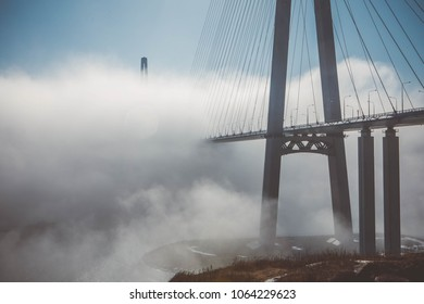 Beautiful view of Russky Bridge in fog. Russian Bridge. Sights of Vladivostok