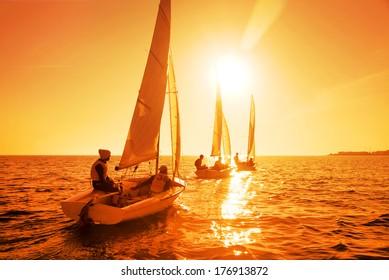 Beautiful view of sailing yachts at sunset