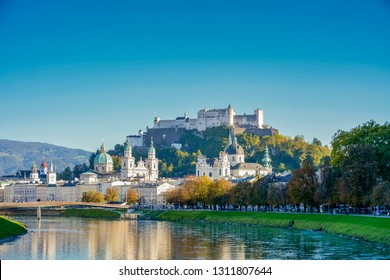Beautiful view of Salzburg skyline with Festung Hohensalzburg and Salzach river in summer, Salzburg, Salzburger Land, Austria. Salzburg is on town banks of River Salzach, at northern boundary of Alps.