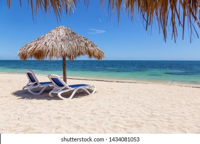 Beautiful view of a sandy beach, Playa Ancon, on the Caribbean Sea in Triniday, Cuba, during a bright and sunny day.
