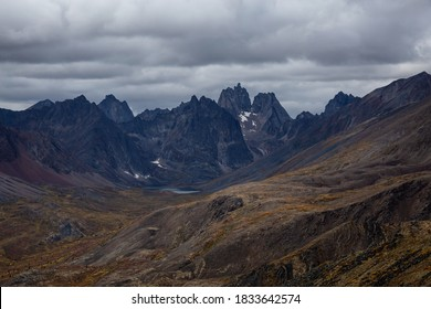 Beautiful View of Scenic Mountains, Lake and Landscape during the Fall Season in Canadian Nature. Taken in Tombstone Territorial Park, Yukon, Canada.