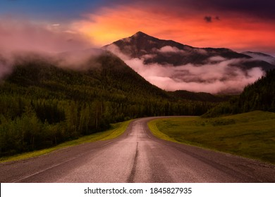 Beautiful View of a scenic road, Alaska Hwy, in the Northern Rockies during a sunny and cloudy morning sunrise. Dramatic Sky Artistic Render. Taken in British Columbia, Canada. Nature Background