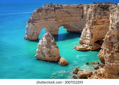 Beautiful view of sea arch in Praia da Marinha beach in Algarve, Portugal.