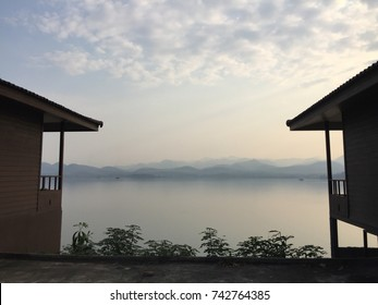 Beautiful view of the sea and mountain in the evening from wooden bungalows in Thailand