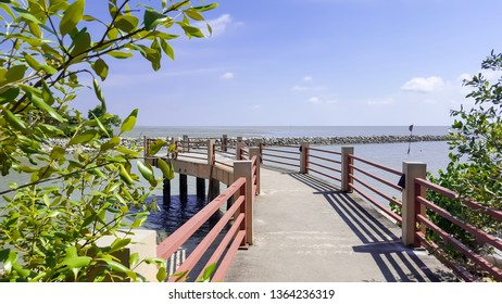 The beautiful view of a sea over the wooden bridge