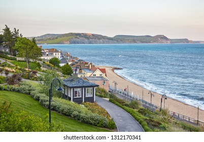 The beautiful view from the Seafront gardens to the Jurassic Coast of Lyme Regis and Lyme Bay with the Dorset coast including the Golden Cap on the background. West Dorset. England
