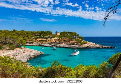 Beautiful view at the seaside of Majorca Spain, bay with turquoise blue water and anchoring boats.