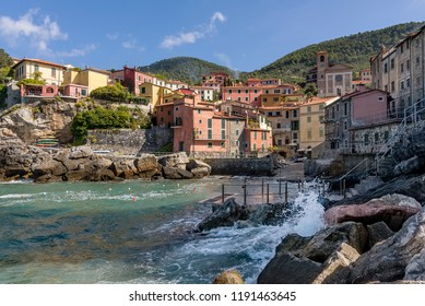Beautiful view of the seaside village of Tellaro on a sunny day, La Spezia, Liguria, Italy, with the waves crashing on the rocks