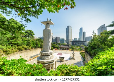 Beautiful view of Seoul skyline from Bongeunsa Temple at Gangnam District in Seoul, South Korea. Back view of Buddha statue. Scenic cityscape on summer sunny day.