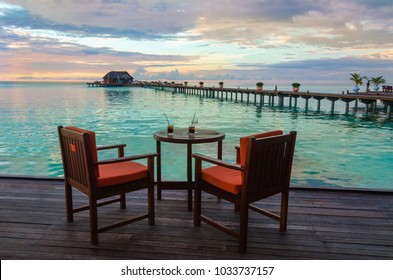 A beautiful view of the setting sun over a restaurant on the water, Maldives