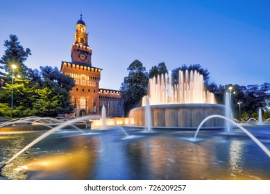 Beautiful view of Sforza Castle (Castello Sforzesco) with fountain at night, Milan, Italy. This castle was built in the 15th century by Francesco Sforza, Duke of Milano.  Famous landmark of Milan.