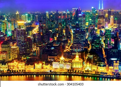 Beautiful view of  Shanghai -  Bund or Waitan waterfront at night. Shanghai waterfront Bund has historical buildings and it is one of the most famous tourist places in Shanghai.