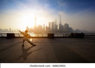Beautiful view of Shanghai Skyline at sunrise with people doing Tai Chi. Shanghai China
