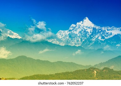 Beautiful view of Silerygaon Village with Kanchenjunga mountain range at the background, moring light, at Sikkim, India