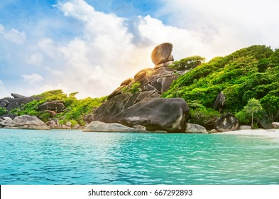 Beautiful view of Similan no.8 island ,Similan national park in the morning with sunlight against blue sky , Phuket inThailand